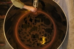 Pumping over the wine from a barrel into a tank at Kingston Family Vineyards in Chile which then looks like a planet.